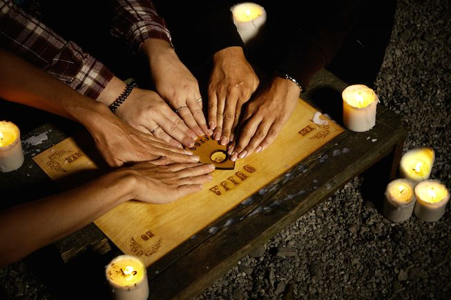 Ouija Board hands