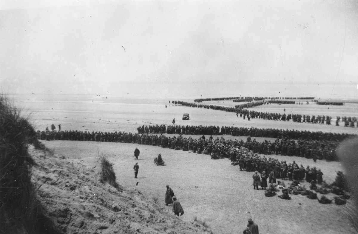 British Expeditionary Forces queued up on the beach at Dunkirk as they await evacuation