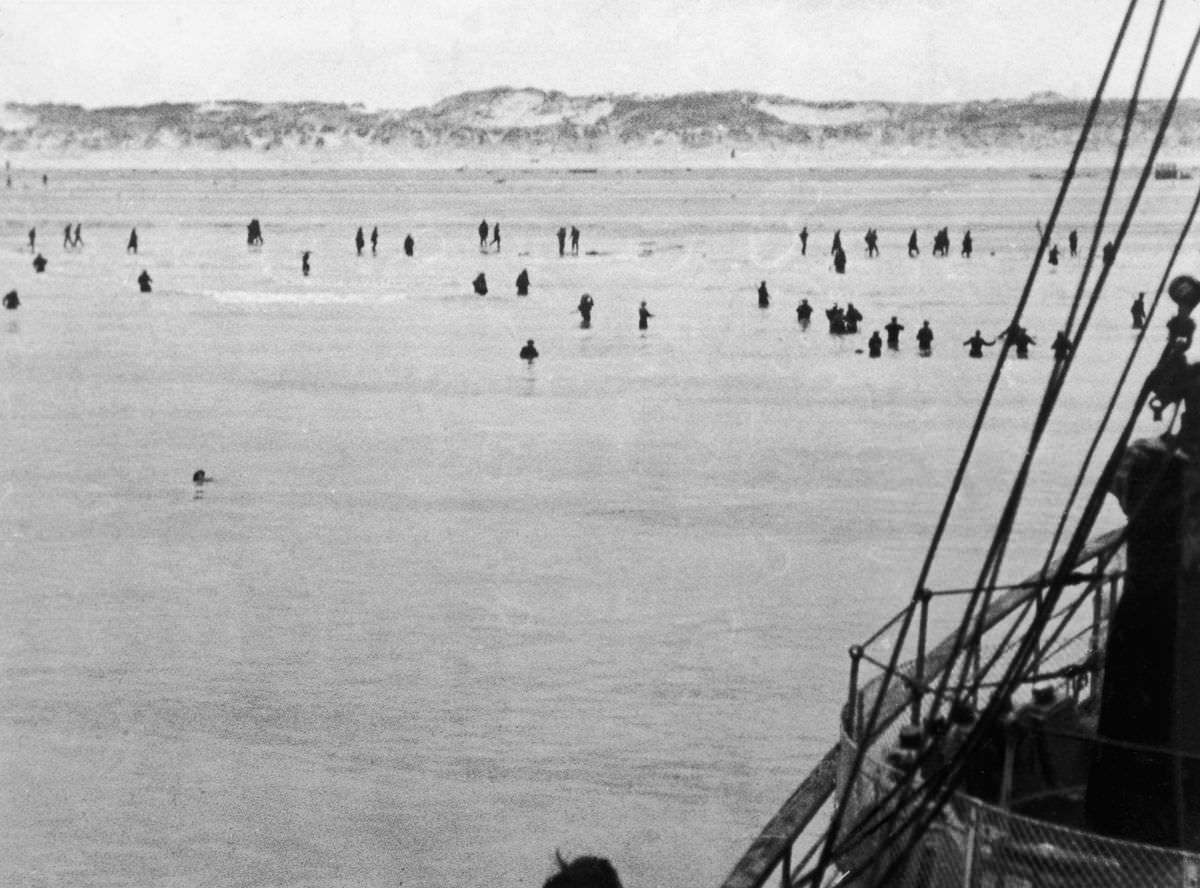 British and French troops wade out to evacuation ships off Dunkirk beach