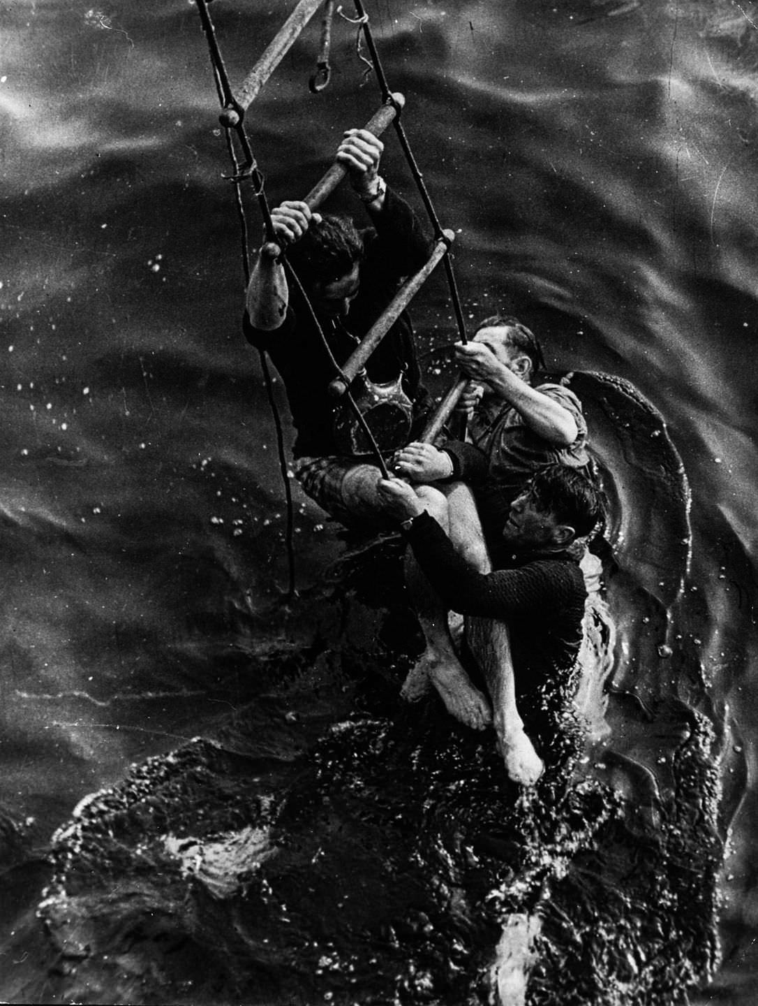 Allied soldiers climb aboard a ship during the evacuation of Dunkirk