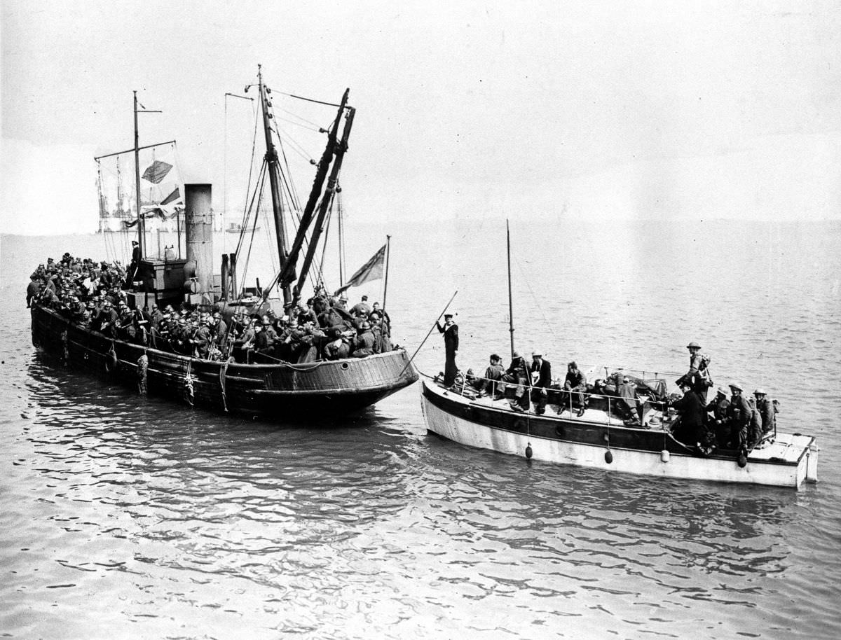 Some of the last troops to be evacuated crowd aboard two civilian boats