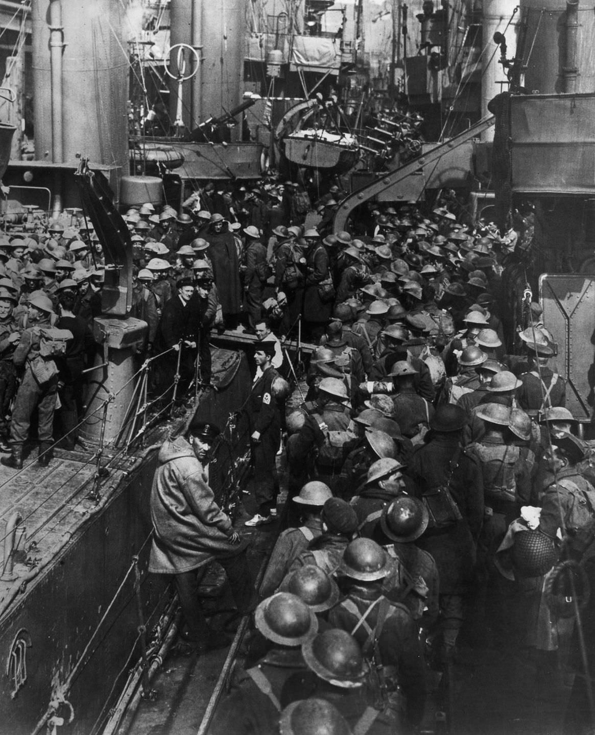 Allied troops crowd aboard ships during the evacuation of Dunkirk