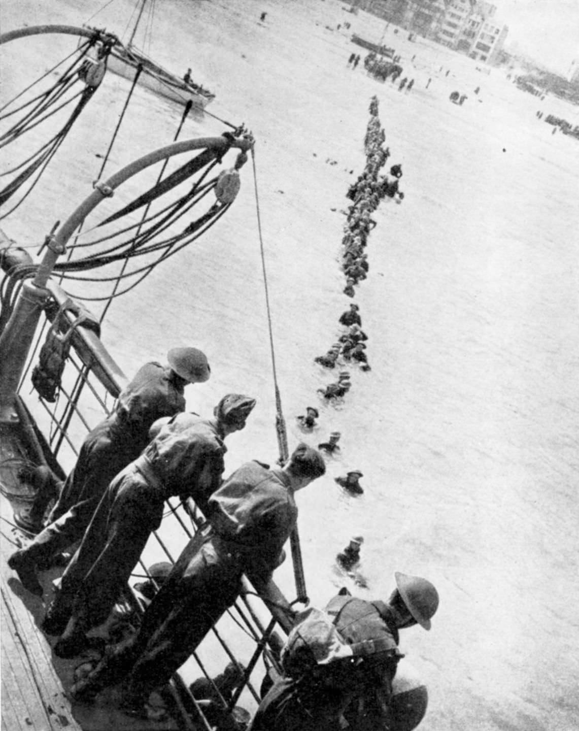 Allied troops wade to evacuation ships off the beach at Dunkirk