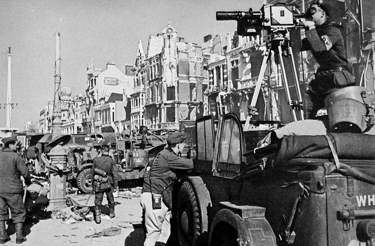 A German cameraman records the departure of the last Allied troops from Dunkirk