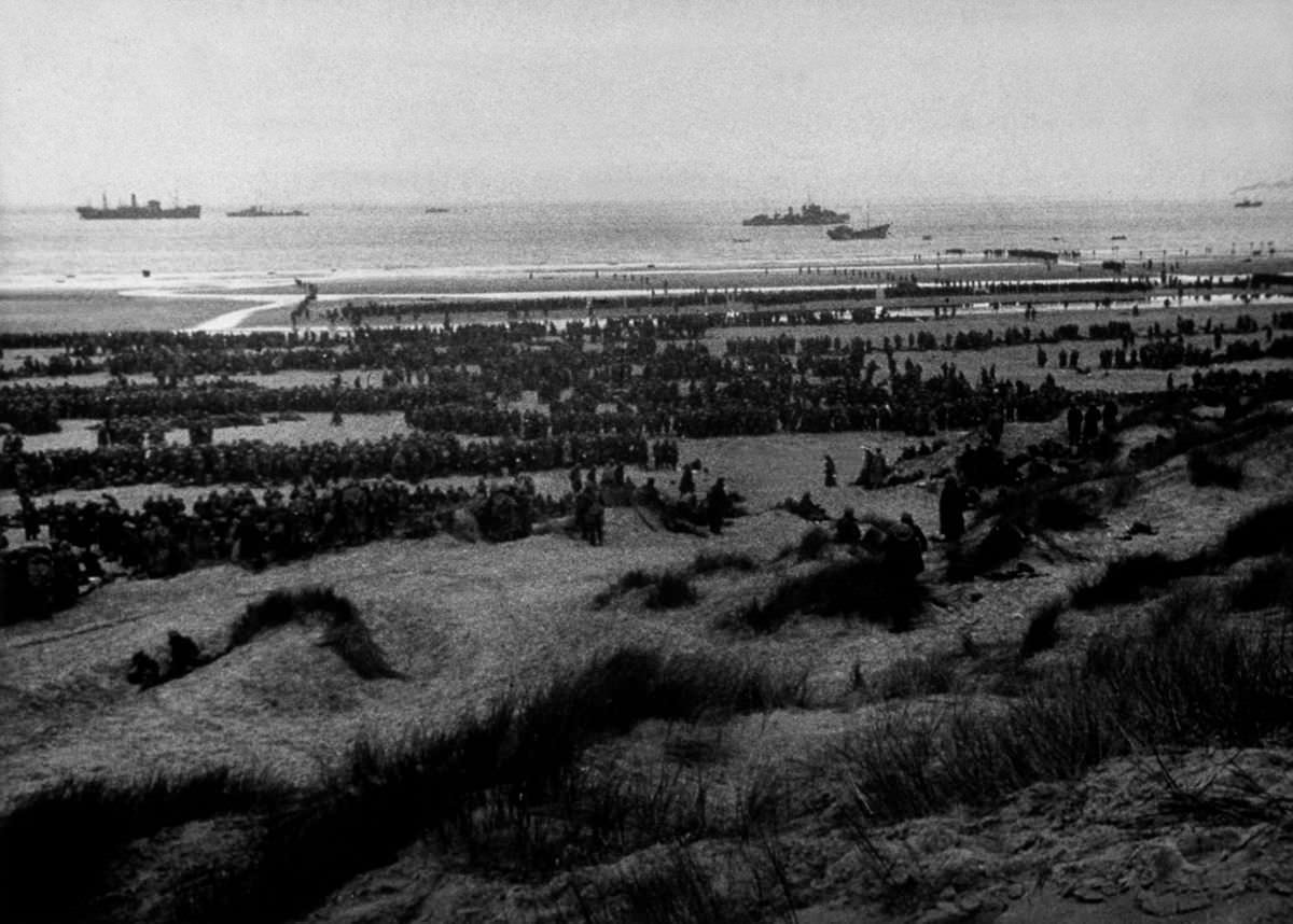 British Expeditionary Forces queue up on the beach at Dunkirk to await evacuation
