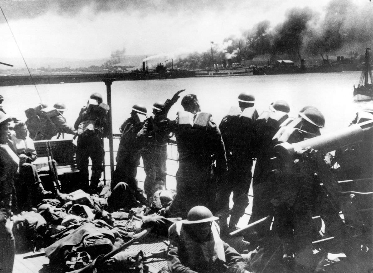 British Expeditionary Forces view the Nazi bombardment of Dunkirk from an evacuation transport